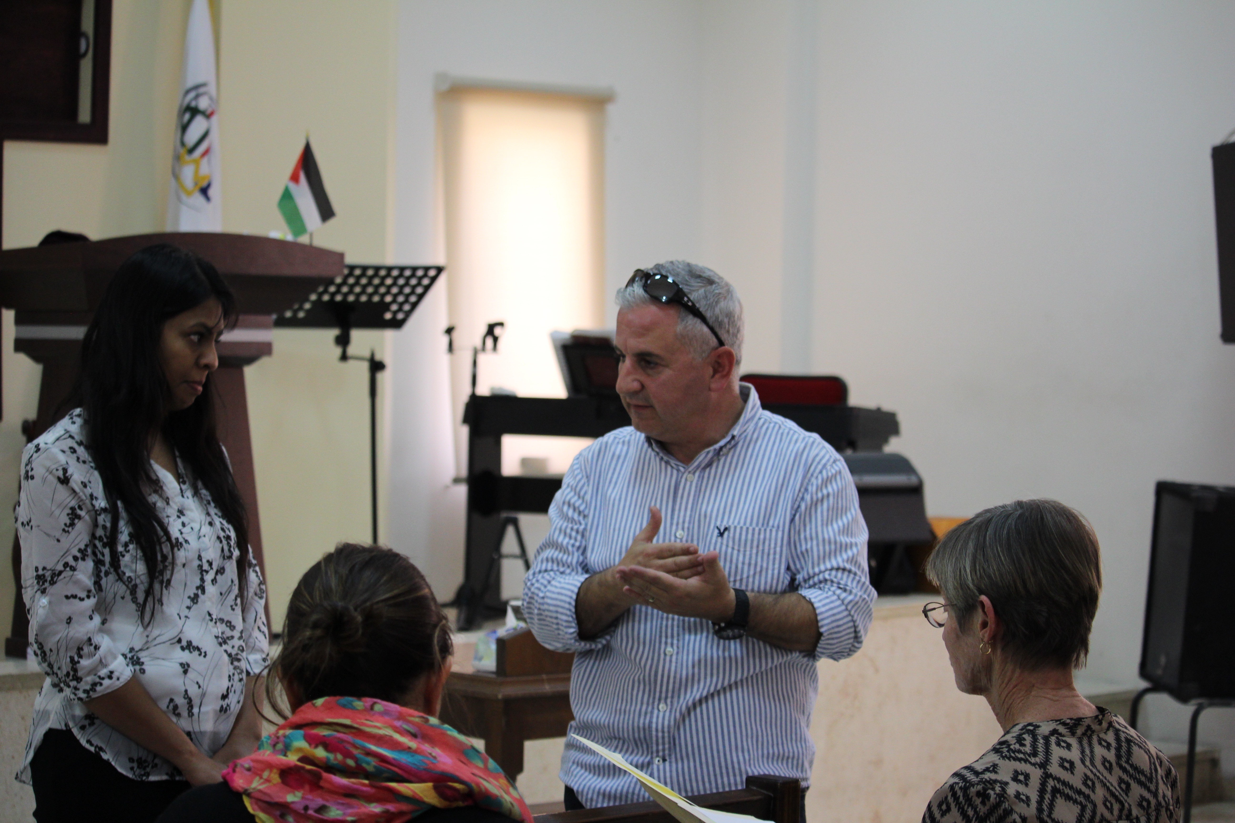 Pastor Hassan and Sarah speak to the staff and teachers.